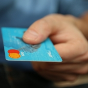 blue credit card in hand